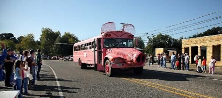 The famous pink hog bus on parade in downtown Ben Wheeler, Texas